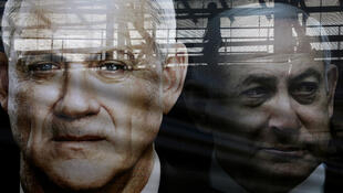 2020 03 01 A banner depicts Gantz and Netanyahu Reuters Ammar Awad