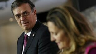 Mexico's Secretary-designate of Foreign Affairs, Marcelo Ebrard listens to Canada's Foreign Minister Chrystia Freeland during a press conference in Ottawa October 22, 2018