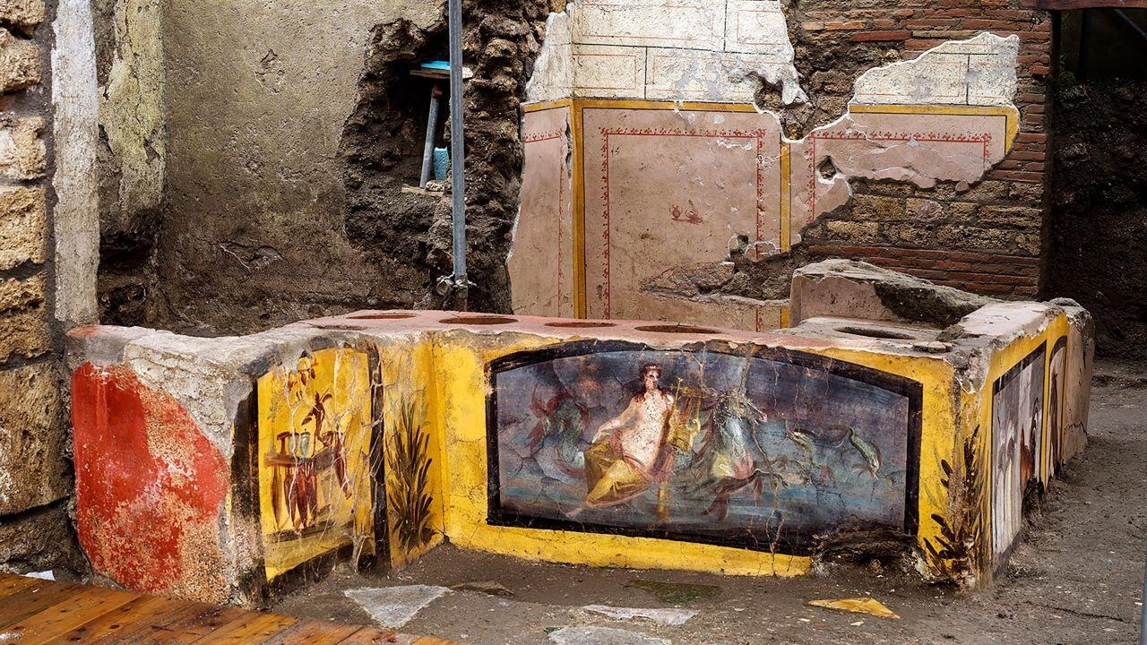Archaeologists uncover well-preserved 'fast food' counter in Pompeii