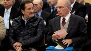 Former IMF chief Rodrigo Rato (on the right) was jailed in October for participating in a fraud scandal at failed Spanish bank Bankia