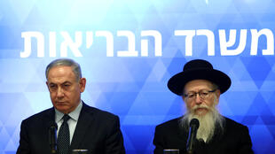 Israeli Prime Minister Benjamin Netanyahu (left) and Health Minister Yaakov Litzman give a joint press conference regarding preparations and new regulations for the coronavirus, in Jerusalem on March 4, 2020.