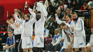 French players celebrate during the 24th Men's Handball World Championships final match between France and Qatar at the Lusail Multipurpose Hall in Doha on February 1, 2015