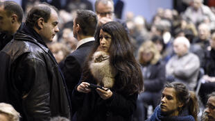 Charlie Hebdo journalist Zineb El Rhazoui (centre) at French cartoonist Charb's funeral