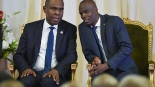 Haitian Prime Minister Jean-Henry Ceant (L), seen here speaking with President Jovenel Moise in 2018, has been censured by the lower house of Parliament