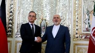 Iran's Foreign Minister Mohammad Javad Zarif (R) receives his German counterpart Heiko Maas in the capital Tehran on June 10, 2019 for talks on the future of the nuclear deal
