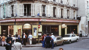 People stand in front of the Jo Goldenberg restaurant at rue des Rosiers in Paris on August 11, 1982 – two days after it was devastated by an attack by gunmen who threw a grenade into the restaurant and shot at customers with sub-machine guns, killing six customers and injuring 22 others.