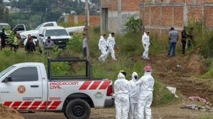 Forensic and civil protection personnel work at a clandestine grave where local authorities have found at least 16 bodies, in Agua Escondida neighborhood,in Tonala, Jalisco state, Mexico, in October 2018.