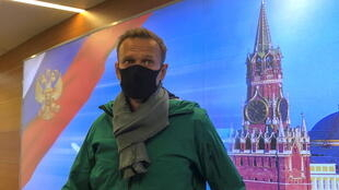Russian opposition leader Alexei Navalny pictured moments before his arrest at Moscow's Sheremetyevo airport on Sunday.