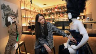 Designer Rimante Rimgailaite prepares mannequins at a restaurant