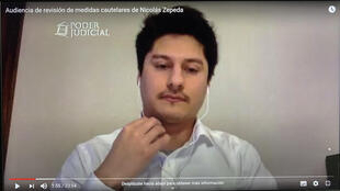 An image grab shows Nicolas Zepeda attending a virtual court on his extradition case in Santiago, on May 27, 2020