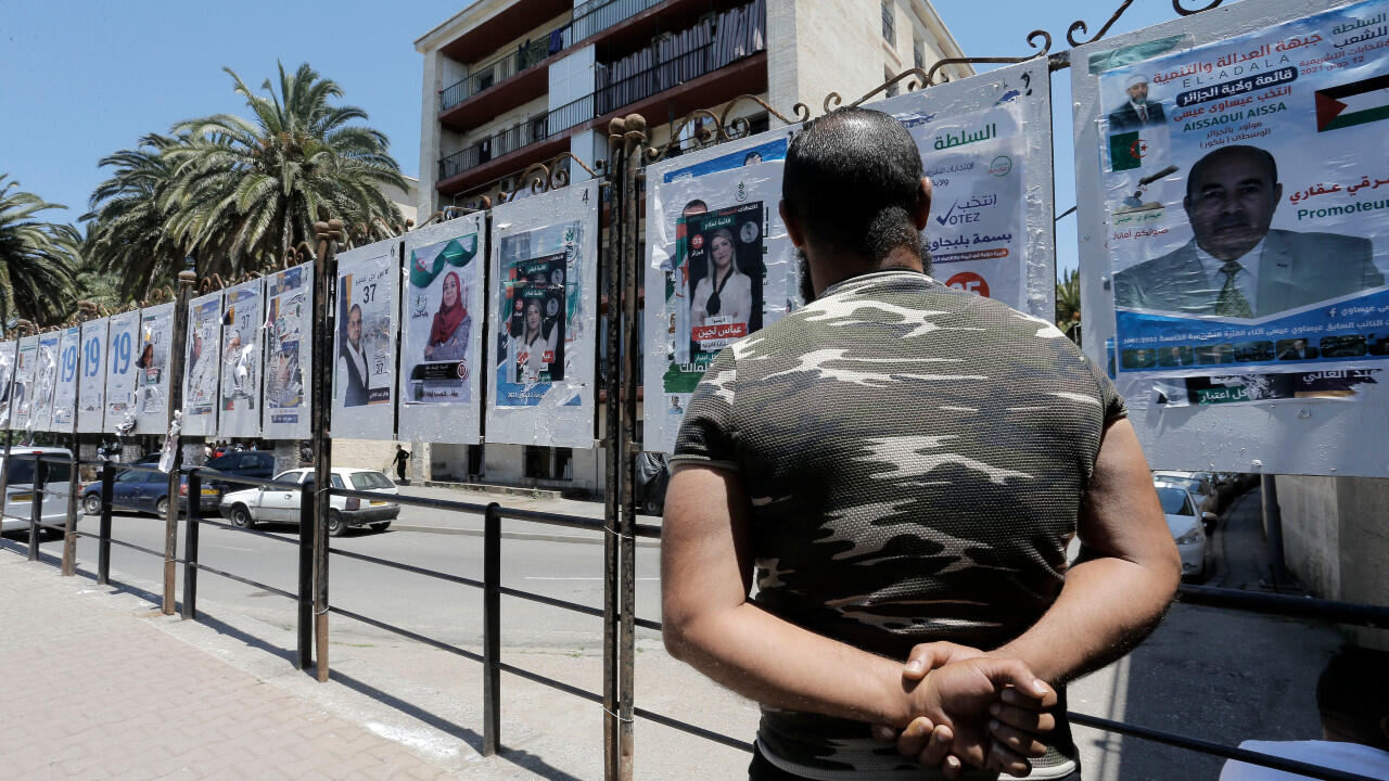 Algerians vote in divisive parliamentary elections in 'climate of repression'