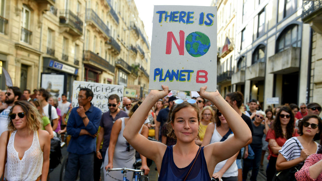 Protesters call for more action on climate change in Bordeaux, southwestern France, on October 13, 2018.