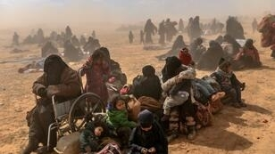 Women and children evacuated from the Islamic State group's embattled holdout of Baghouz are pictured on March 6, 2019