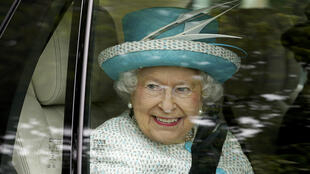 Britain's Queen Elizabeth II smiles as she leaves after her visit Myerscough College in Lancaster, northern England, on May 29, 2015