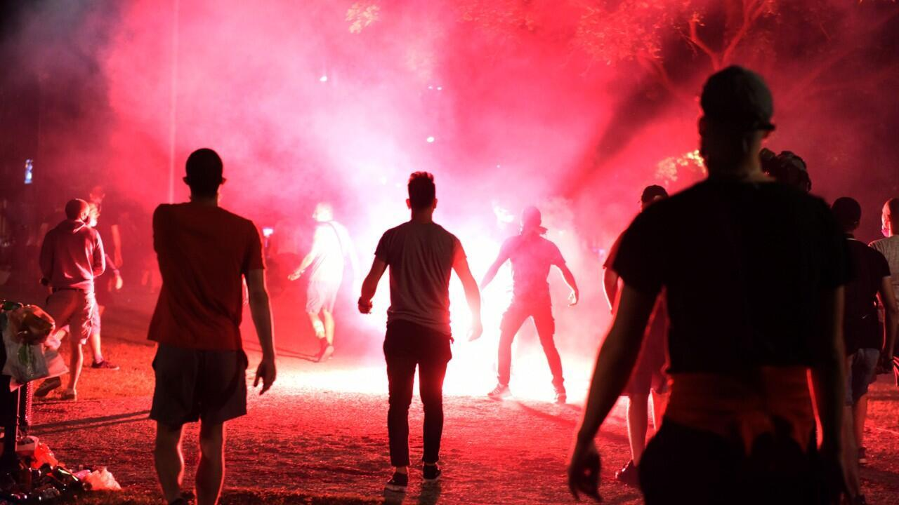 Protesters light flares as they attend a rally against the government's lockdown measures, amid the spread of the coronavirus disease (COVID-19), in front of the parliament in Belgrade, Serbia, July 9, 2020.