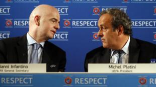 Le secrétaire général de l'UEFA Gianni Infantino et le président Michel Platini, en février 2014.