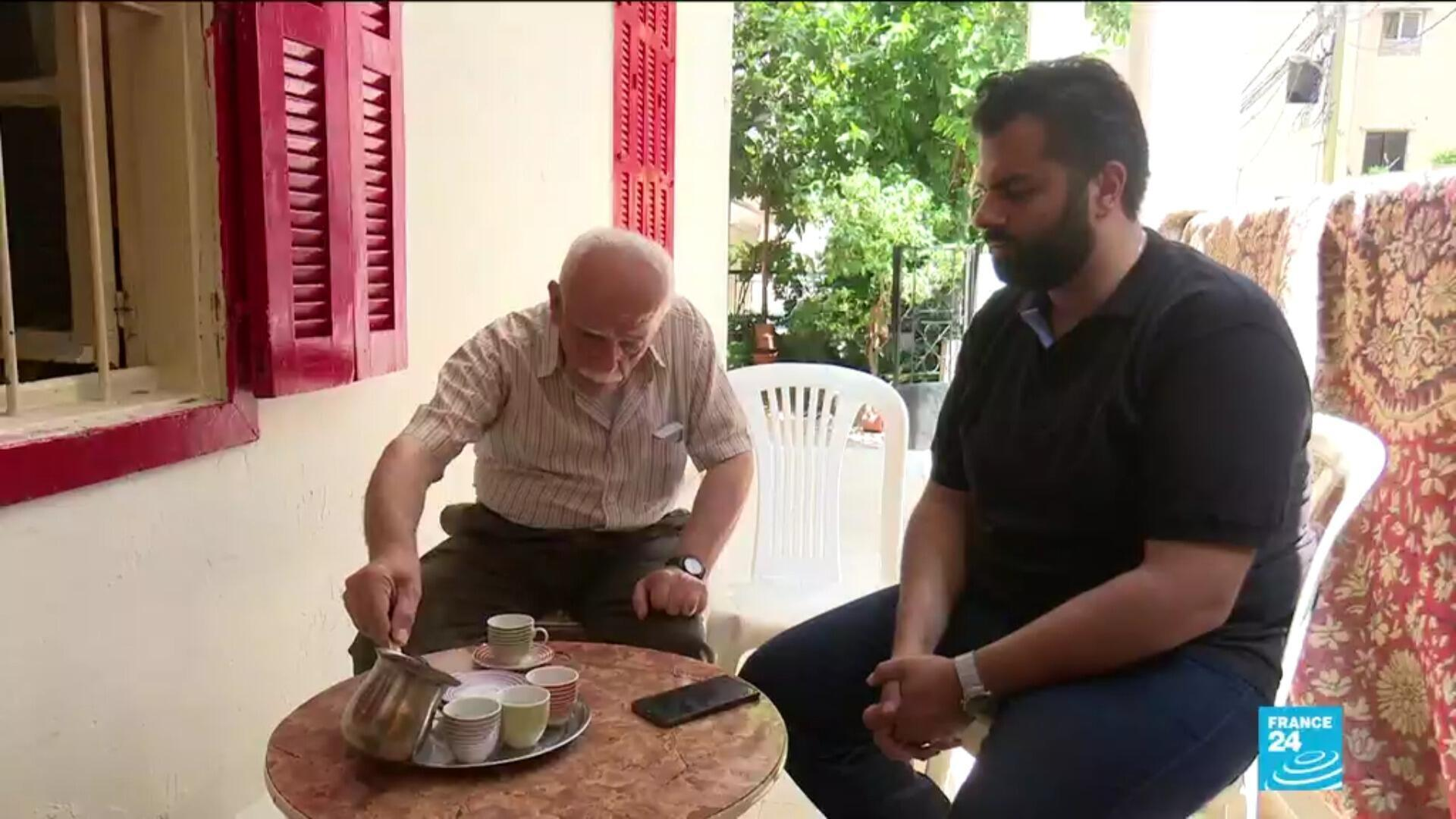 Georges Jassous (L) and his family have cut back on food purchases as the value of Lebanon's currency has fallen sharply.