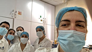 A picture taken by a nurse at the Hotel-Dieu de France Hospital shows colleagues posing for a selfie picture in the coronavirus section