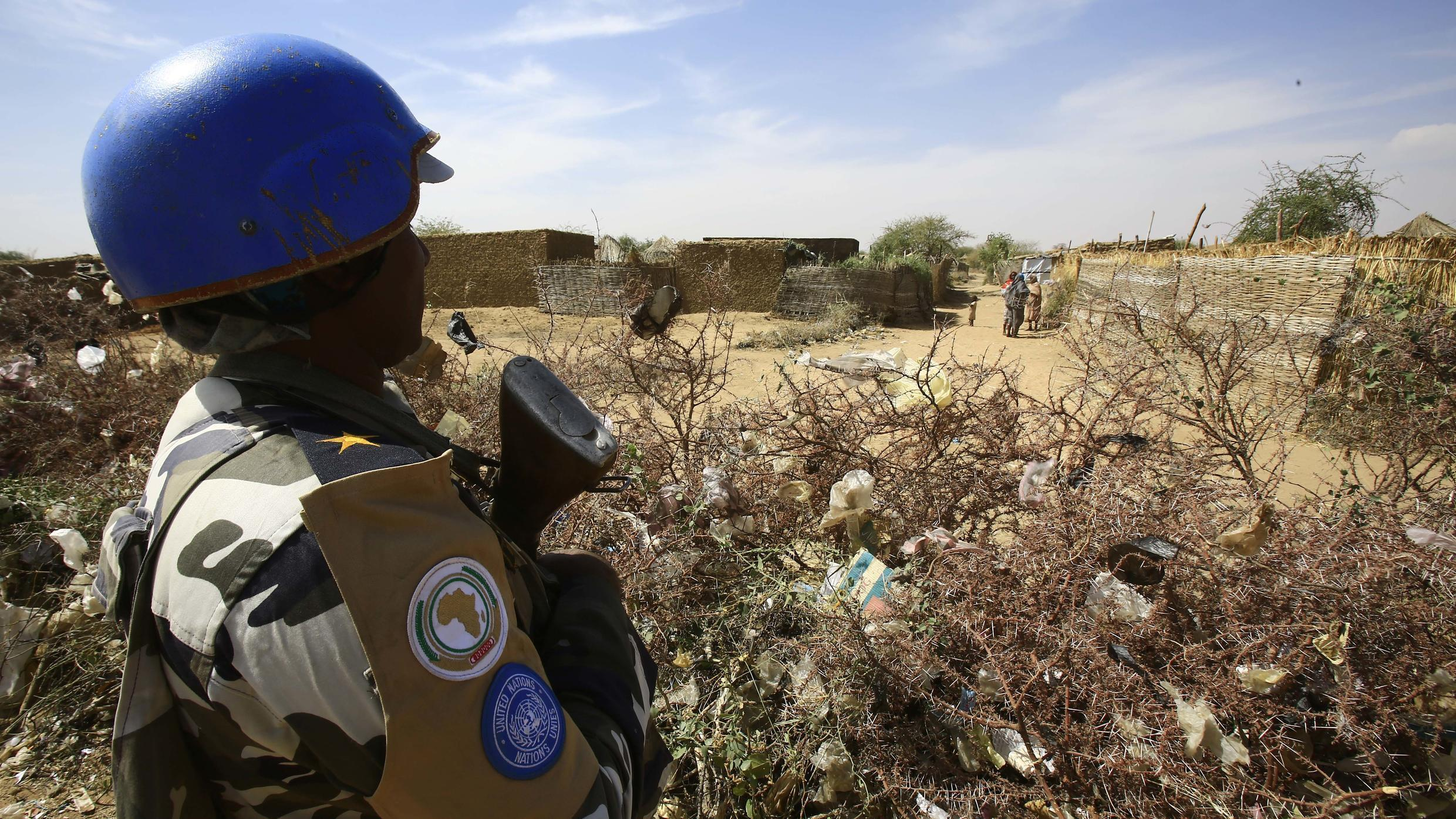A UN peacekeeper stands guard at a refugee camp in the city of Nyala, in South Darfur, on January 9, 2017.