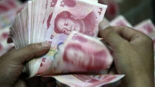 Des billets de 100 yuans.