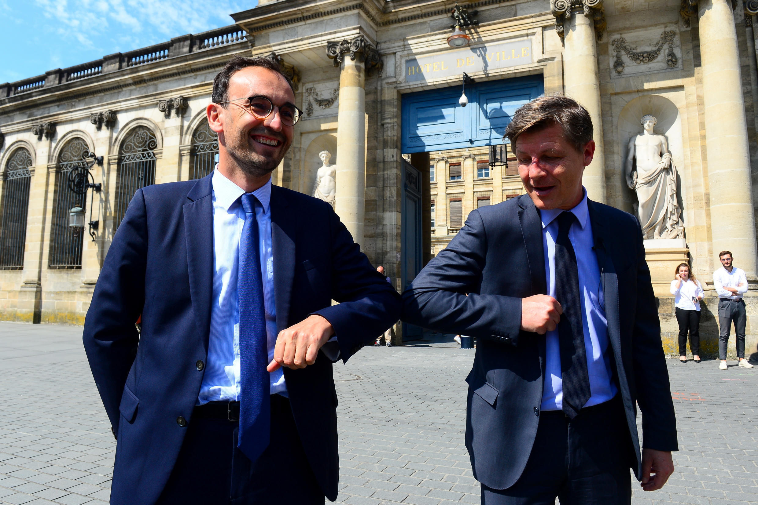 Les Republicains right wing party's incumbent mayor of Bordeaux Nicolas Florian and LREM's candidate to the mayoral elections Thomas Cazenave (L) touch eachothers elbows to avoid spreading the novel coronavirus Covid-19 as they announce an alliance ahead of the June 28 vote, in Bordeaux on June 3, 2020.