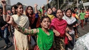 Thousands of garment workers are on strike to demand higher wages