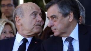 Alain Juppé et François Fillon (D), le 15 octobre 2016 à Nice, lors de l'hommage national aux victimes de l'attentat du 14 juillet.