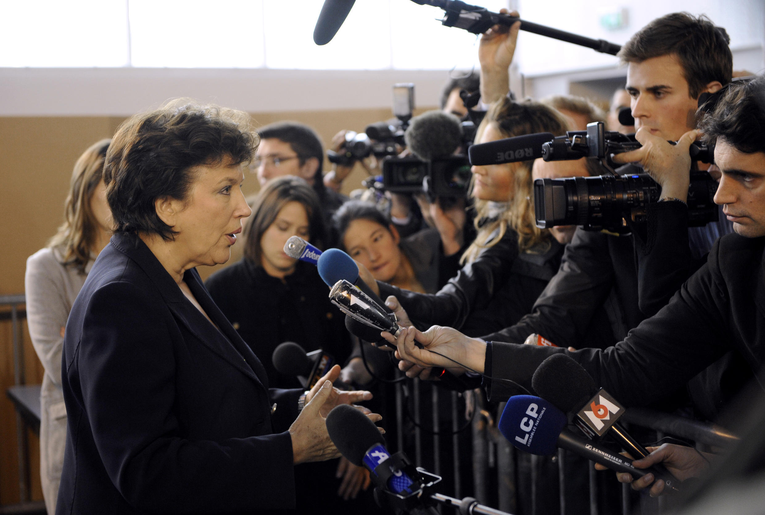Former Health Minister Roselyne Bachelot talks to the press after being vaccinated for the H1N1 influenza on November 12, 2009.