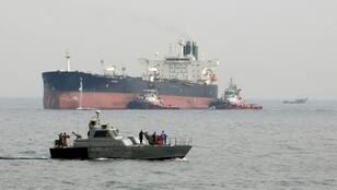 An Iranian military speedboat patrols as a tanker prepares to dock at an oil facility at Khark Island, March 12, 2017