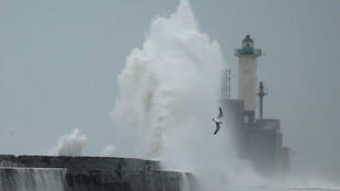 Waves crash against a lighthouse during Storm Ciara at Boulogne-sur-Mer, France, on February 9, 2020.