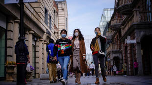 People wearing face masks are seen in a main shopping area less than a week after the lockdown to prevent the spread of Covid-19 was lifted in Wuhan, China on April 14, 2020.