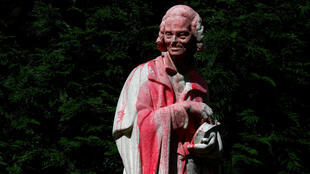 voltaire statue red paint