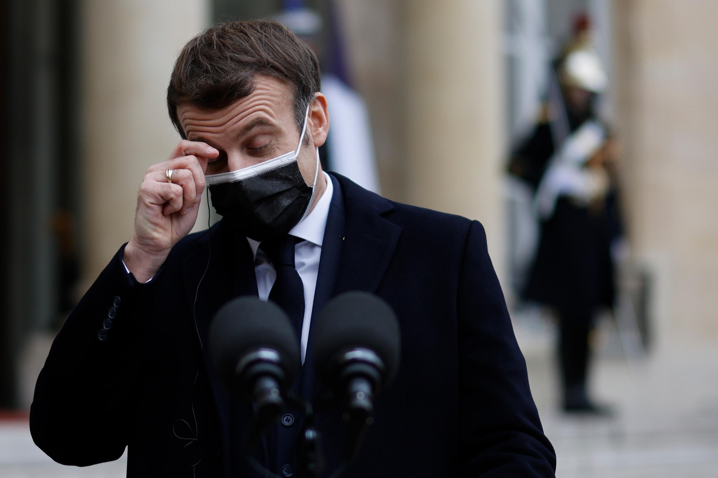 French President Emmanuel Macron scratches his eye as he addresses the press upon the arrival of Portugal's prime minister for a working lunch at the Élysée presidential palace in Paris on December 16, 2020.