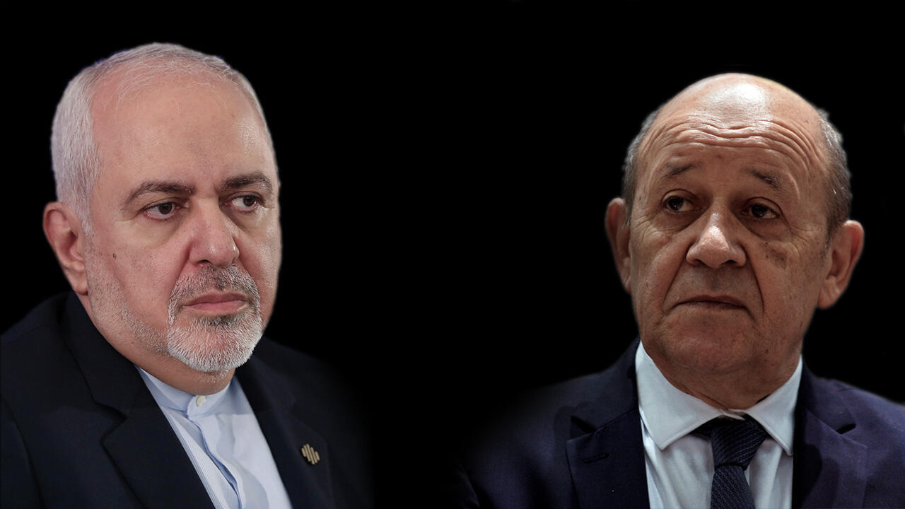 El ministro de Relaciones Exteriores iraní, Mohammad Javad Zarif (izq.) y su homólogo francés, Jean-Yves Le Drian (der.)
