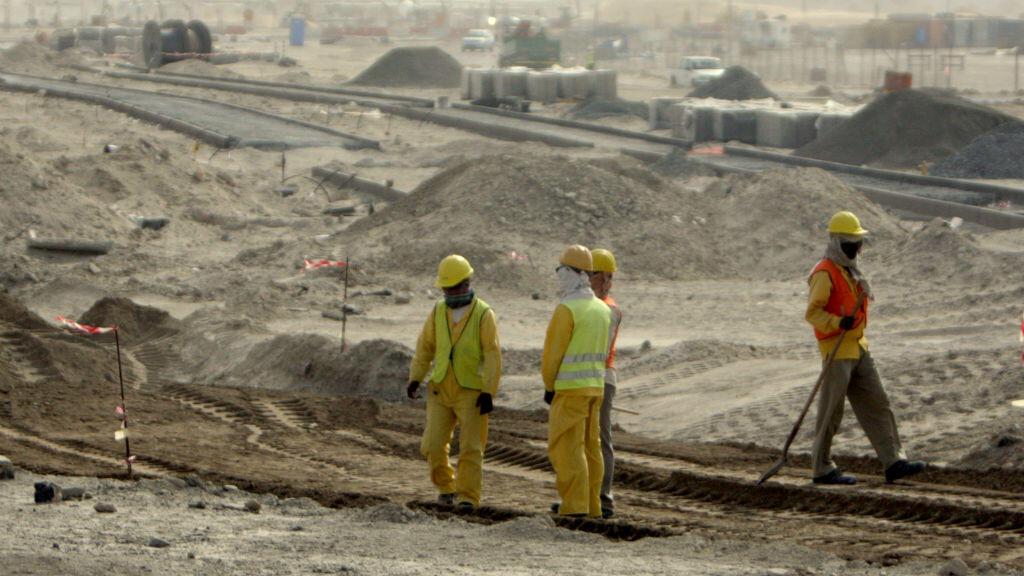 Des ouvriers sur le site de construction de l'île de Saadiyat à Abu Dhabi.