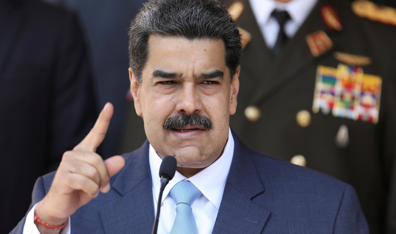 نيكولاس مادورو خلال مؤتمر صحفي في قصر ميرافلوريس بكراكاس في 12 مارس/آذار 2020.