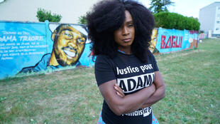 Assa Traore, sister of Adama Traore, a 24-year-old black Frenchman who died in a 2016 police operation, poses during an interview in Beaumont-sur-Oise, near Paris, June 7, 2020.