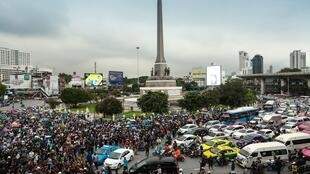 Pro-democracy protesters gather at Victory Monument in Bangkok to rally for the fourth consecutive day in defiance of an emergency decree banning gatherings