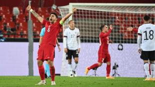 Turkey's Ozan Tufan celebrates Kenan Karaman's equaliser