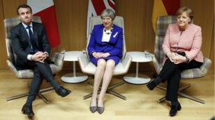 Emmanuel Macron, Theresa May et Angela Merkel à Bruxelles le 22 mars 2018.