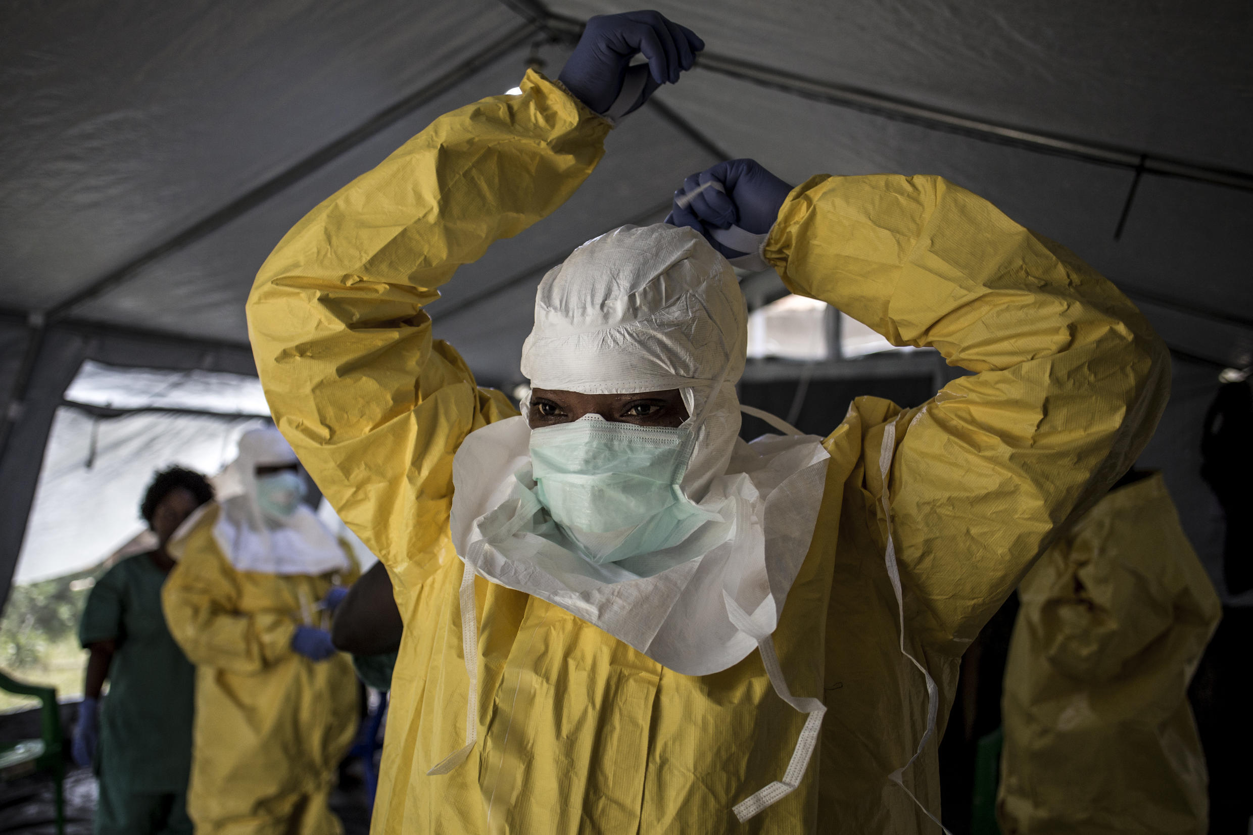 Medical staff put on protective gear before entering an Ebola treatment centre in the northeastern city of Beni, Democratic Republic of Congo, August 18, 2018.