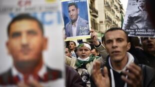 Protesters in Algiers call for the release of jailed opposition leader Karim Tabbou on September 27, 2019.
