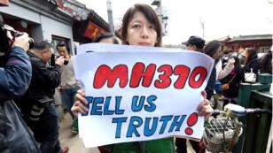 Manifestation des proches des disparus du  Boeing 777 du vol MH370, début mars en Chine.