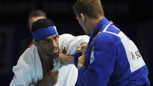 Iran's Saeid Mollaei, in white, shown fighting on August 28, 2019 against Belgium's Matthias Casse during the semi-final of the men's under 81kg category of the Judo World Championships in Tokyo
