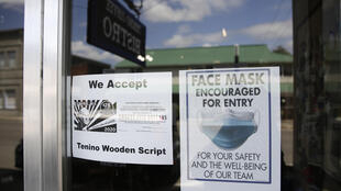 A sign at Tenino Coffee Bistro in Washington state announces the shop accepts the city's wooden money, created to help businesses hit hard by the coronavirus pandemic