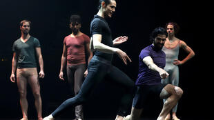 Uruguayan footballer Edinson Cavani on stage with members of the Uruguayan National Ballet as part of a campaign to popularize classical dance among young boys in soccer-mad Uruguay