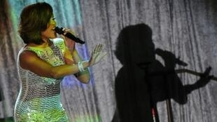 The late American singer Whitney Houston performing onstage during the 2011 Pre-Grammy Gala & Salute to Industry Icons