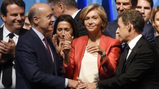 Alain Juppé et Nicolas Sarkozy, le 27 septembre 2015, à Nogent-sur-Marne, pendant la campagne des élections régionales.