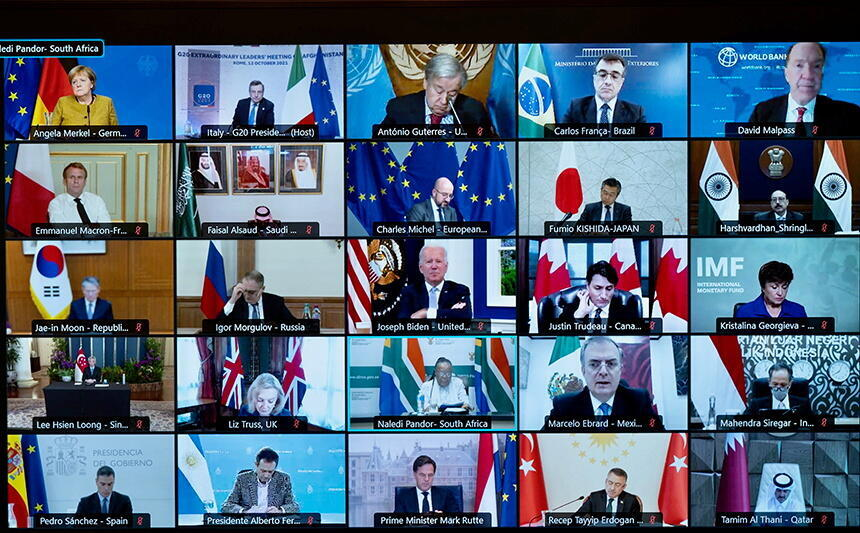 A screen shows international leaders as they virtually participate in an extraordinary G20 meeting on Afghanistan, in Rome, Italy, on October 12, 2021.
