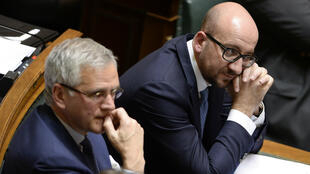 Fed up already? Belgium's new PM Charles Michel (right) endures a gruelling first day in parliament